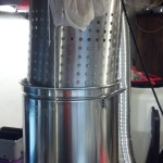 Brew Boss Strainer Basket suspended above the kettle